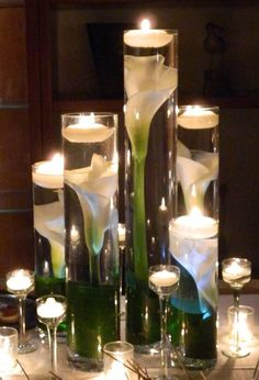 Simple, but very elegant. These would be easy to replicate to. Just hot glue gun your fake flower of choice to the bottom of the glass, fill with water, and add the floating candle.