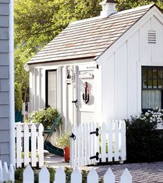 garden shed in the backyard + white picket fence --This so so cute. I would love to be able to build a garden shed in my yard like this! Outdoor Spaces, Outdoor Living, Backyard Sheds, Garden Sheds, Backyard Barn, White Picket Fence, White Fence, Picket Fences, Potting Sheds
