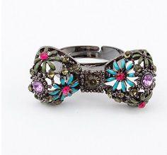 http://cupcakefairyks.loja2.com.br/2419440-Anel-de-laco-estilizado