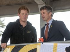 Spectator: Prince Harry watches on from the stands with Crown Prince Fredrick of Denmark at the Lee Valley Athletics Centre where events of the Invictus Games are being held today, 11 September 2014.