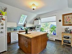 #kitchen inside a heritage home built in 1905! Love the #island Love how all the natural light can come in and brighten up the room | 700 Princess Avenue #Vancouver| www.krynitzki.com http://www.strathconahomesforsale.com