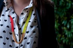 Make a neon-dipped necklace with spray paint. | 47 DIYs For The Cash-Strapped Music Festival-Goer