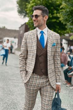 man in bold checked suit