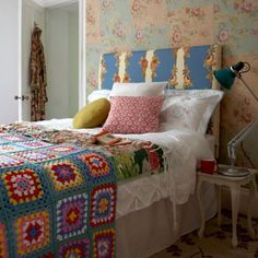love the cluttered cozy collected unplanned feel of this sweet bedroom
