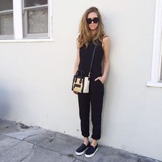 Chiara Ferragni wearing a black jumpsuit, dior shades and celine bag and sneakers.