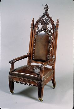 Armchair  Attributed to Thomas Brooks  (1810/11–1887)  Date: ca.1847 Geography: Mid-Atlantic, New York City, New York, United States Culture: American Medium: Rosewood, brass, leather, replacement upholstery