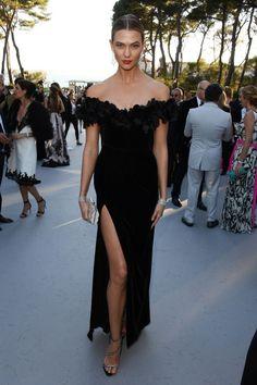 In a Marchesa dress, Giuseppe Zanotti Design shoes, and Chopard jewelry.