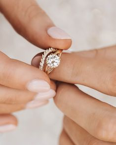 Introducing one of our newest settings, the Geranium! This beautiful ring is shown here with our new wedding band, the Arched Domino Marquise.