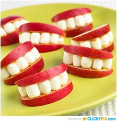 "These marshmallow and apple slices resemble smiles, and could be served with an inspirational quote such as ""smile and go the extra mile!"" I like these snacks because they meet halfway between healthy and sugary. These are made with peanut butter so if a student of mine were to have a peanut allergy, I would replace the peanut butter with honey or cream cheese."