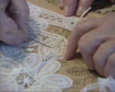 Making needlepoint lace, verifying a pattern - close up. Needlepoint lace is amongst the finest and most expensive of 19th century products ...