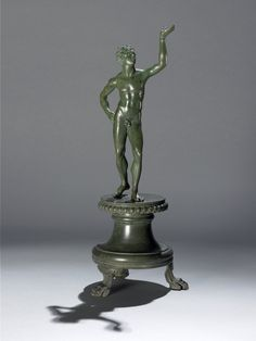 Bronze Lamp Stand Roman Century BC- Century AD Found Perugia, Italy Bronze lamp-stand in the form of a young naked African male, with his right hand on his hip and his left hand raised to. Roman Sculpture, Bronze Sculpture, Sculpture Art, Masculine Art, Art Rules, Roman Art, 1st Century, Western Art, Antiquities