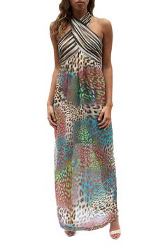 Stunning, full, floor lengthed maxi dress featuring Trina Turk's stylish painted leopard print! Has a gorgeous, two button criss cross halter neck, and leads down to a side slit. Solaris Dress by Trina Turk. Clothing - Dresses - Maxi Avalon, New Jersey