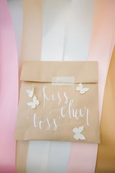 """kiss cheer toss"" bag of confetti for the ceremony // photo by The Bird & The Bear // http://ruffledblog.com/handcrafted-oak-tree-manor-wedding"