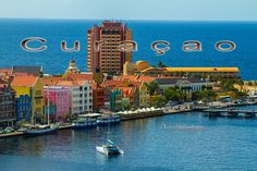 A view from the bridge. Curaçao, a Dutch Caribbean island, is known for its beaches tucked into coves and its expansive coral reefs rich with marine life. The capital, Willemstad, has pastel-colored colonial architecture, floating Queen Emma Bridge.