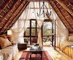 Wow, this is simple luxury in my book. Love the sheer curtains over the wall of windows.