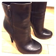 High heeled booties These are Aldo black leather 5 inch heel booties. They have a side zipper on the outside of the boot. They are practically brand new, only been worn a few times, but they are a little too high for my liking. ALDO Shoes Ankle Boots & Booties