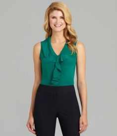 Emerald: Ruffles cascade down the front of an otherwise simple silk top.
