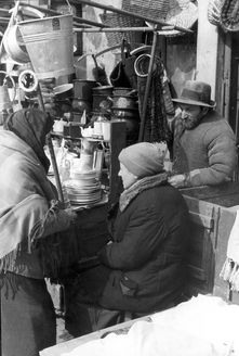 Warsaw, Poland, May 1941, Selling kitchen utensils in a ghetto mark...  Share:  13490321445716820892.JPG