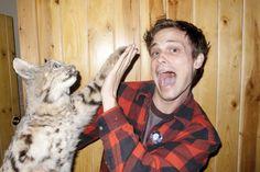 Matthew Gray Gubler high fiving his cat!