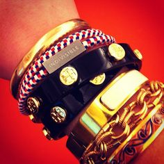 Tory Burch arm party.