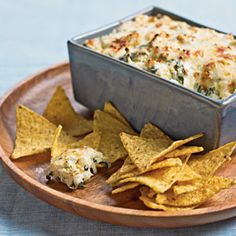 Spinach-and-Artichoke Dip  Best Appetizer. This warm, creamy, cheesy dip appears frequently at staff gatherings. People make it time and again because it's tasty and a snap to prepare. Assemble up to two days ahead, and bake just before serving.
