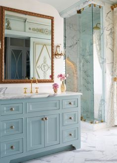 The master bath has a walk-in, marble shower. Photo by Jean Allsopp.