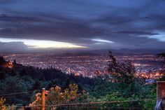 A view of the city at night from La Calera route. A perfect scene for a perfect dinner. Come and visit us at www.Going2Colombia.com