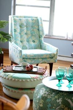 Fabric by Amy Butler- This chair and ottoman would be good in a personal office, library, or sitting room. While the ottoman with the teal glassware would look great with my other living room ideas.