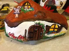 Beautiful little fairy house hand painted rock