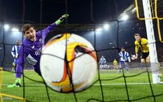 Iker Casillas of FC Porto watches the ball at the back of the net as Lukasz Piszczek (R) of Borussia Dortmund heads the ball to score his team's first goal during the UEFA Europa League round of 32 first leg match between Borussia Dortmund and FC Porto at Signal Iduna Park on February 18, 2016 in Dortmund, Germany.