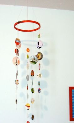 Memory mobile!  Print out illustration from favorite picture books, and cut circles around the pictures.  It is easy for children to make this project & hang in their room.