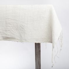 Reminiscent of classic Parisian textiles, this square cotton tablecloth with its subtle ribbed accents is perfect for a twilight picnic or a sunny breakfast nook. $115.00-$170.00