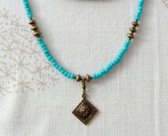 Turquoise and Antique Brass Nacklace or Wrap by baublesbybethann, $34.00