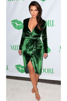 Kim Kardashian shows off her cleavage in a green, velvet wrap dress at the Midori Makeover Parlour at Fred Segal on September 25, 2012 in Santa Monica, CA.
