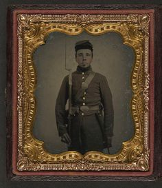 [Unidentified soldier in Union uniform and eagle breast plate with bayoneted musket, cap box, and bayonet scabbard] (LOC) by The Library of Congress, via Flickr