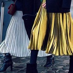 Style the pleated skirt in metallic with black stockings, black ankle boots and a black knit ✔️#SakerStil #styleinspiration #Styletips #Guide #Style #ModernStyle #trends #pleats #pleatedskirt #metallic #streetstyle