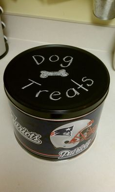 Old popcorn tin reborn. I painted the top with chalkboard paint and now keep the dog treats inside. I'd obviously not do this as the Patriots but I like the idea of the chalkboard paint. Popcorn Tin, Dog Store, Chalkboard Paint, Dog Treats, Coffee Cans, Dog Bowls, Recycling, Jar, Crafty