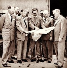 Walt Disney and his cast members making plans.