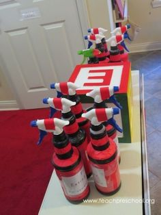 Putting out fires with our DIY fire extinguishers! A great dramatic play addition to a classroom!: