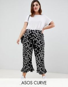 d3b83fa9b17 ASOS DESIGN Curve pants with fluted ruffle hem in mono animal print   plussizeclothing  plussizeapparel