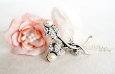 rhinestone brooch art deco clear crystal swarovski ivory pearl mothers day gift ideas tibetan silver plated jewelry gift accessories by sestras on Etsy https://www.etsy.com/listing/127140302/rhinestone-brooch-art-deco-clear-crystal