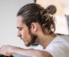 Longer hair for men has become mainstream and with it came the man bun. What is a man bun? Well, it's a cool alternative to the ponytail for pulling long hair up and back. Man Bun Haircut, Bun Hairstyles For Long Hair, Undercut Hairstyles, Male Hairstyles, Men's Hairstyle, Man Bun Styles, Hair And Beard Styles, Curly Hair Styles, Popular Haircuts