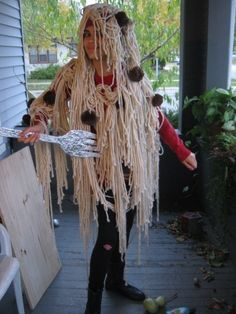 Glue beige yarn and brown pom-poms onto a hoodie to go as spaghetti and meatballs. | 21 Insanely Creative Dollar Store Halloween Costumes That Will Impress Everyone
