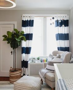 Helena Glazer (of Brooklyn Blonde) used navy and white striped curtains for her son's nursery. Click for more pictures inside her Brooklyn home.