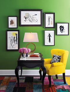 Cute and quaint home office. The yellow chair and rug brightens this office of green, black, and white.  Wow!