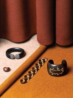 Wood, gold and gemstones, clockwise from far left: Van Cleef & Arpels ring, Hemmerle cuff, Cathy waterman cuff, Verdura bracelet.