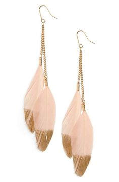 Blush-pink feather earrings tipped in shimmering gold gilt are the perfect shoulder-skimming accessory when you want a bit of boho charm with an elegant touch.