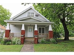 this updated 4 bedroom 3 bath home is a must see!  This Craftsman-style home has vinyl siding, fenced yard and is on a corner lot.