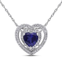 This beautiful necklace from the Miadora Collection features a heart-cut created blue sapphire surrounded by a double frame of white diamonds. This lovely heart pendant is hung on a rope chain and is set in 10-karat white gold.