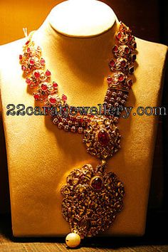 Jewellery Designs: Dull Finished Uncut Diamond and Ruby Set